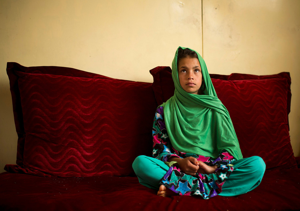 ". Zardana, 11, sits as she talks in Kandahar, Afghanistan on Monday, April 22, 2013 about a pre-dawn last year when a U.S. soldier burst into her family\'s home. Zardana said her visiting cousin saw the soldier chasing them and ran to help, but he was shot and killed. ""We couldn\'t stop. We just wanted somewhere to hide. I was holding on to my grandmother and we ran to our neighbors.\"" (AP Photo/Anja Niedringhaus)"