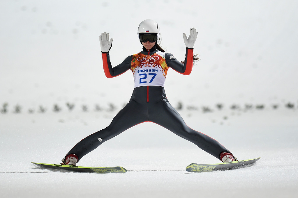 . Irina Avvakumova of Russia lands after jumping during the Ladies\' Normal Hill Individual final round on day 4 of the Sochi 2014 Winter Olympics at the RusSki Gorki Ski Jumping Center on February 11, 2014 in Sochi, Russia.  (Photo by Lars Baron/Getty Images)