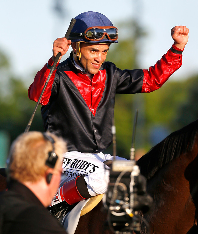 . Jockey Joel Rosario, atop Tonalist, reacts after winning the 146th running of the Belmont Stakes horse race, Saturday, June 7, 2014, in Elmont, N.Y. (AP Photo/Matt Slocum)