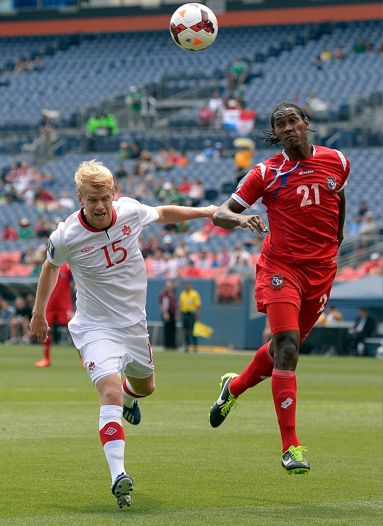 . Richard Dixon #21 of Panama heads the ball away from Kyle Bekker #15 of Canada during the first half of the CONCACAF Gold Cup soccer game July 14, 2013 at Sports Authority Field at Mile High. (Photo By John Leyba/The Denver Post)