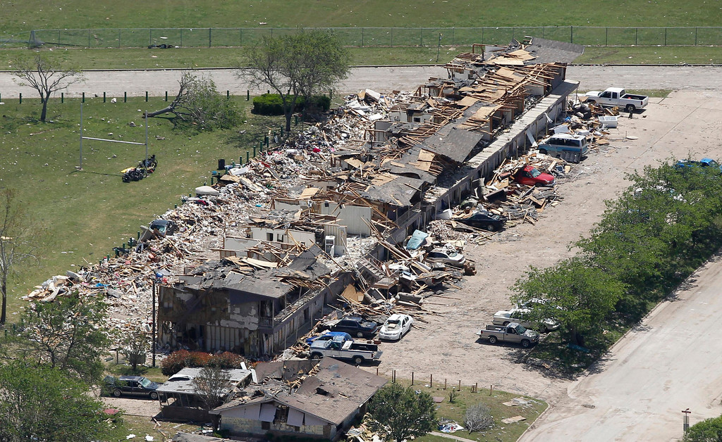. A block of residences is pictured near the site of a fertilizer plant explosion in West, Texas, pictured from the air as U.S. President Barack Obama and First Lady Michelle Obama (not pictured) assess the damage from Marine One April 25, 2013, on their way to a memorial service for the victims who died, at Baylor University in Waco. REUTERS/Jason Reed
