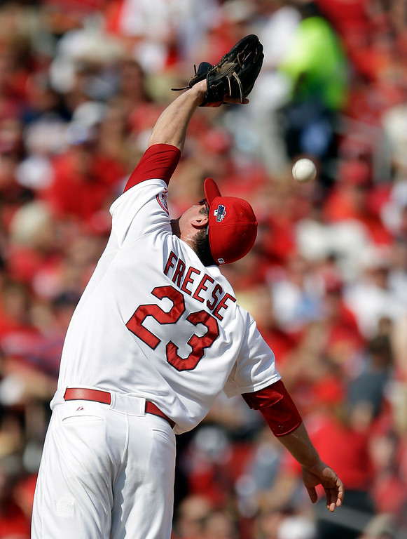 . St. Louis Cardinals third baseman David Freese can\'t handle a ball hit by Pittsburgh Pirates\' Marlon Byrd in the seventh inning of Game 2 of baseball\'s National League division series on Friday, Oct. 4, 2013, in St. Louis. Freese was given an error on the play. (AP Photo/Jeff Roberson)