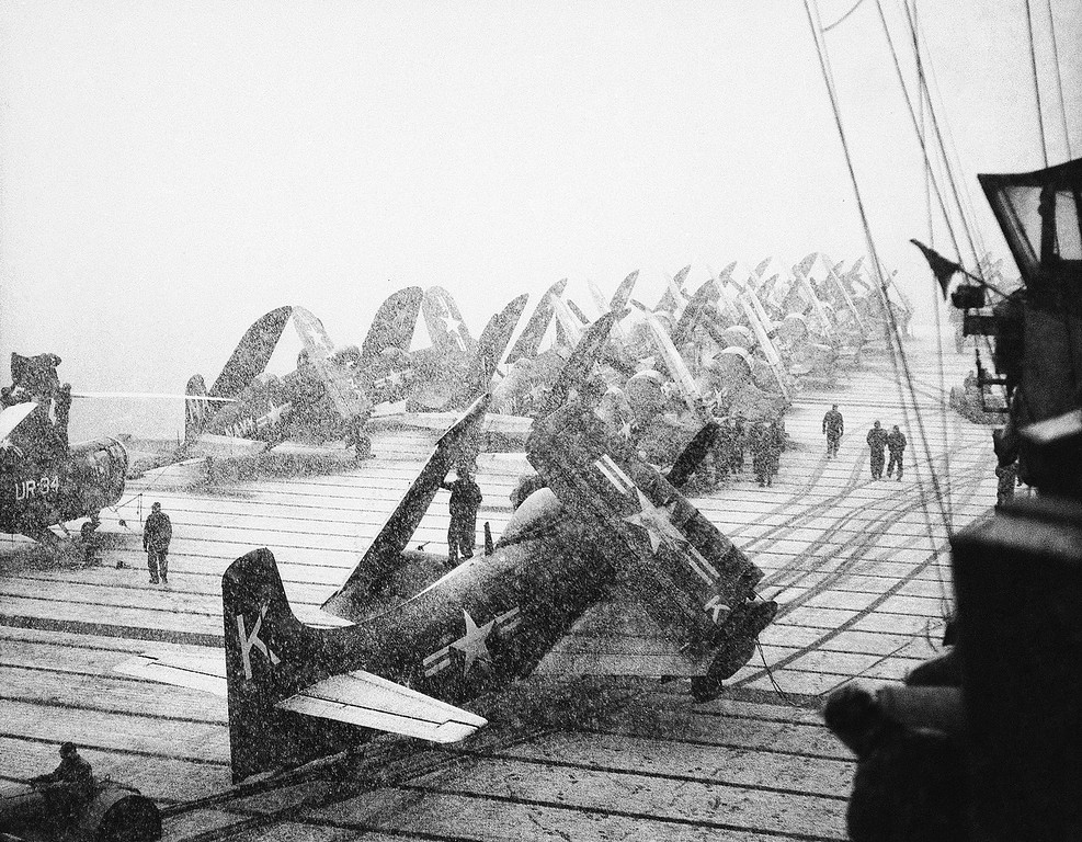 . A blinding snowstorm in Korean waters halts flight operations aboard the Aircraft Carrier Leyte on Dec. 16, 1950. The planes are already loaded with bombs, rockets and 20mm projectiles and were again in action a short time after the storm ended. (AP Photo)