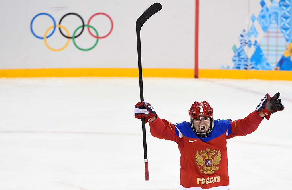 . Russia\'s Olga Sosina celebrates after scoring a goal during a Women\'s Ice Hockey Group B match between Russia and Germany at the Shayba Arena during the Sochi Winter Olympics on February 9, 2014. JONATHAN NACKSTRAND/AFP/Getty Images