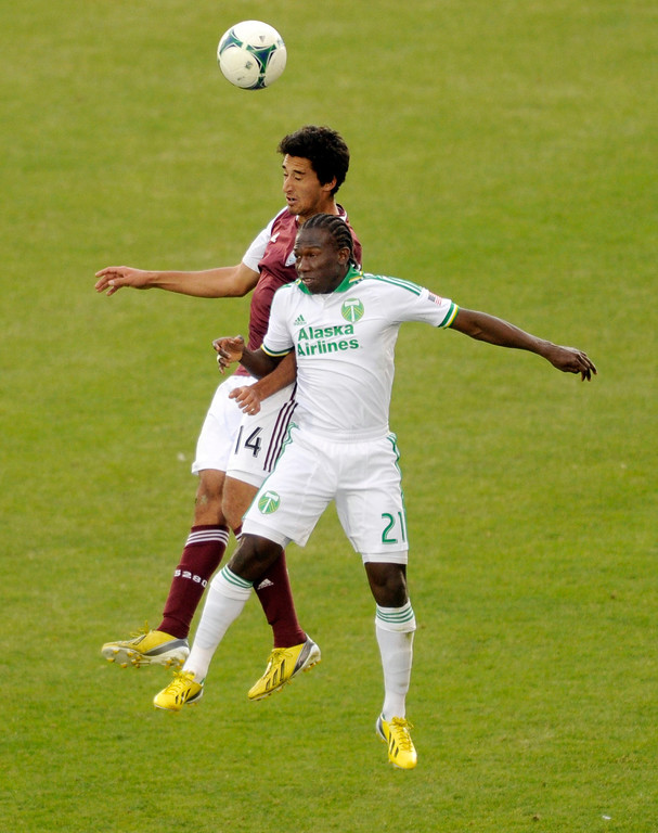 . Rapids\' forward Tony Cascio (14) headed the ball over Timbers\' midfielder Diego Chara (21) in the second half. The Colorado Rapids tied the Portland Timbers 2-2 Saturday, March 30, 2013 at Dick\'s Sporting Goods Park in Commerce City.  Photo By Karl Gehring/The Denver Post)