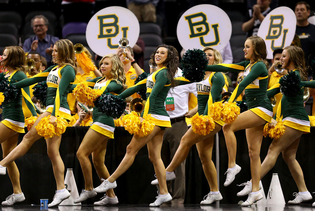 . Baylor Bears cheerleaders perform during the third round of the 2014 NCAA Men\'s Basketball Tournament against the Creighton Bluejays at the AT&T Center on March 23, 2014 in San Antonio, Texas.  (Photo by Ronald Martinez/Getty Images)