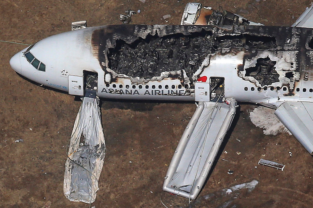 . An aerial view of an Asiana Airlines Boeing 777 plane is seen after it crashed while landing at San Francisco International Airport in California on July 6, 2013. Two people were killed and 130 were hospitalized after the plane crash-landed at San Francisco International Airport on Saturday morning, San Francisco Fire Department Chief Joanna Hayes-White said.  REUTERS/Jed Jacobsohn