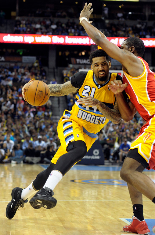 . DENVER, CO. - APRIL 6: Wilson Chandler (21) of the Denver Nuggets drove to the basket guarded by Terrence Jones (6) of the Houston Rockets in the second half. The Denver Nuggets defeated the Houston Rockets 132-114 at the Pepsi Center Saturday night, April 6, 2013. Photo By Karl Gehring/The Denver Post)