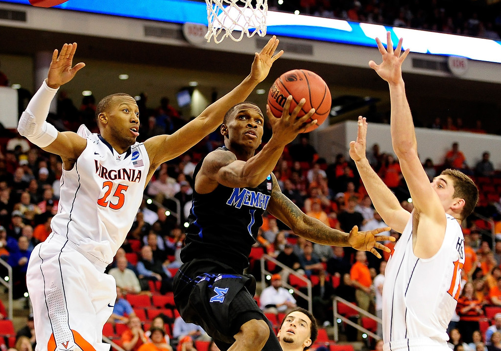 . Joe Jackson #1 of the Memphis Tigers drives to the basket against Akil Mitchell #25 of the Virginia Cavaliers in the second half during the third round of the 2014 NCAA Men\'s Basketball Tournament at PNC Arena on March 23, 2014 in Raleigh, North Carolina.  (Photo by Grant Halverson/Getty Images)