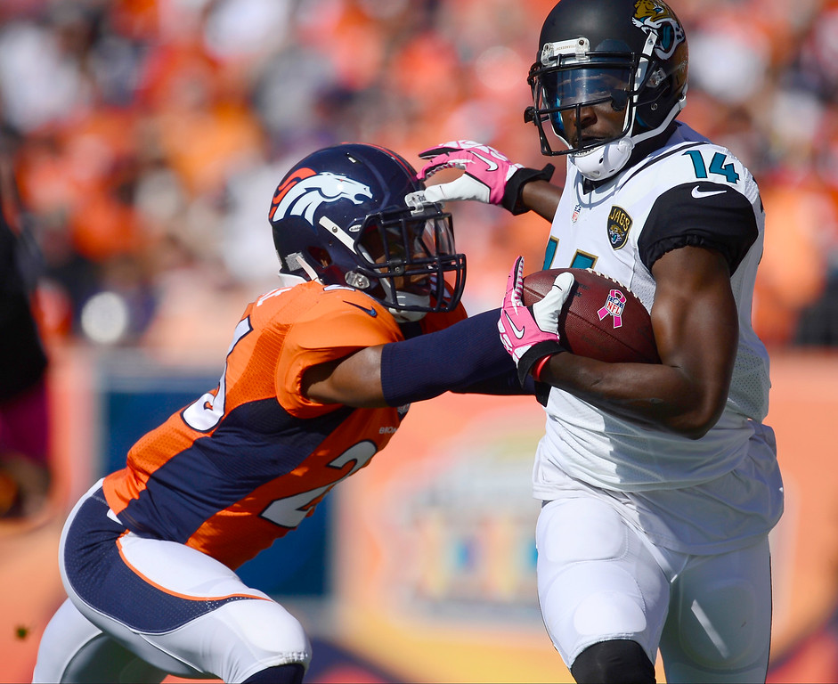 . Jacksonville Jaguars wide receiver Justin Blackmon (14) makes a reception for 23 yards against Denver Broncos free safety Rahim Moore (26) in the first quarter.   (Photo by AAron Ontiveroz/The Denver Post)