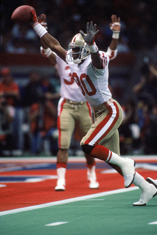 . Wide receiver Jerry Rice #80 of the San Francisco 49ers celebrates on his way to the end zone for a touchdown in Super Bowl XXIV against the Denver Broncos at Louisiana Superdome on January 28, 1990 in New Orleans, Louisiana.   (Photo by George Rose/Getty Images)