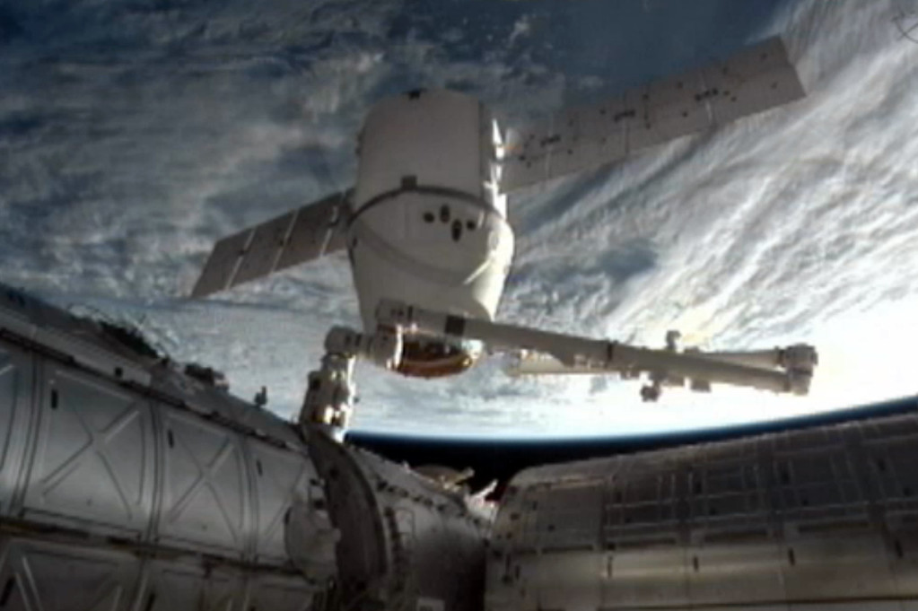 . This image provided by NASA-TV shows the SpaceX Dragon commercial cargo craft as it is backed away from the International Space Station early Tuesday March 26, 2013 by the International Space Station\'s Canadarm2 robotic arm. The Dragon is expected to splash down in the eastern Pacific ocean approximately 246 miles off the coast of Baja Calif., later this morning. (AP Photo/NASA)