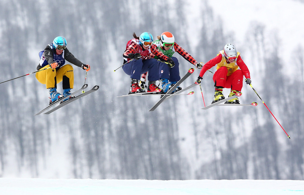 . (L-R) Anna Woerner of Germany, Kelsey Serwa of Canada, Georgia Simmerling of Canada, Fanny Smith of Switzerland compete in the 1/4 final of the women\'s Freestyle Ski Cross event in Rosa Khutor Extreme Park at the Sochi 2014 Olympic Games, Krasnaya Polyana, Russia, 21 February 2014.  EPA/Daniel Karmann
