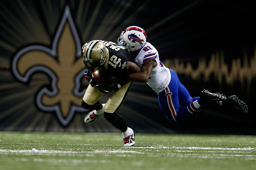 . Marques Colston #12 of the New Orleans Saints is tackled by  Leodis McKelvin #21 of the Buffalo Bills at Mercedes-Benz Superdome on October 27, 2013 in New Orleans, Louisiana.  (Photo by Chris Graythen/Getty Images)