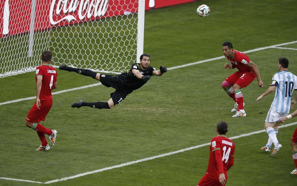. Iran\'s goalkeeper Alireza Haqiqi makes a save during the Group F football match between Argentina and Iran at the Mineirao Stadium in Belo Horizonte during the 2014 FIFA World Cup in Brazil on June 21, 2014. ADRIAN DENNIS/AFP/Getty Images