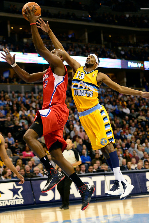 . Denver Nuggets small forward Corey Brewer (13) defends Los Angeles Clippers power forward Lamar Odom (7) during the second half of the Nugget\'s 92-78 win at the Pepsi Center on Tuesday, January 1, 2013. AAron Ontiveroz, The Denver Post