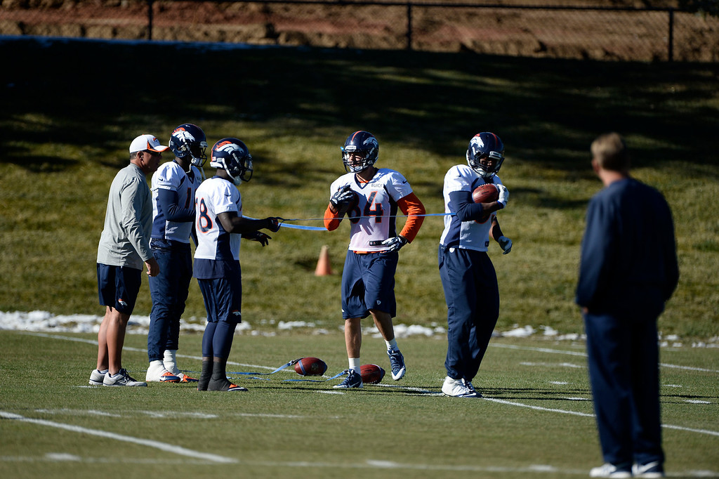 . Denver Broncos receivers and running backs work on holding on to the ball as Interim head coach Jack Del Rio looks on during practice November 27, 2013 at Dove Valley (Photo by John Leyba/The Denver Post)