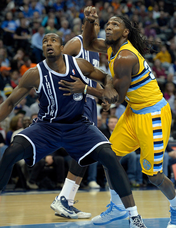 . Denver Nuggets power forward Kenneth Faried (35) battles for position with Oklahoma City Thunder power forward Serge Ibaka (9) during the first quarter January 9, 2014 at Pepsi Center. (Photo by John Leyba/The Denver Post)