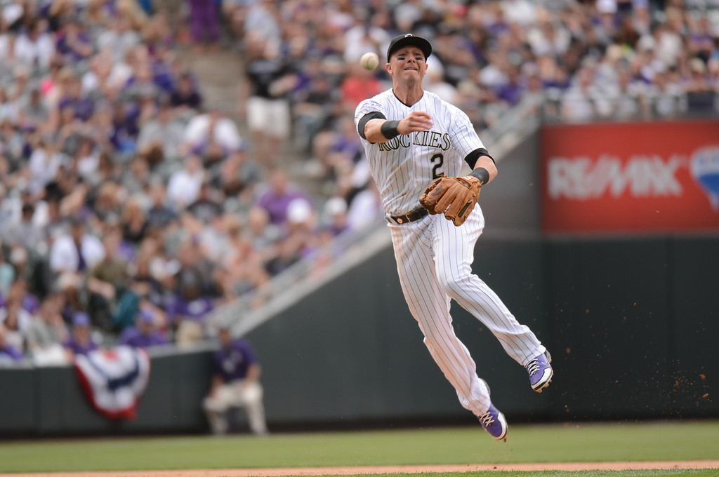 . Troy Tulowitzki (2) of the Colorado Rockies throws out a runner on a ground ball to shortstop in the seventh inning. (Photo by Hyoung Chang/The Denver Post)