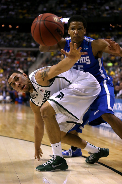 . AUBURN HILLS, MI - MARCH 23:  Denzel Valentine #45 of the Michigan State Spartans loses the ball under pressure from Geron Johnson #55 of the Memphis Tigers during the third round of the 2013 NCAA Men\'s Basketball Tournament at The Palace of Auburn Hills on March 23, 2013 in Auburn Hills, Michigan.  (Photo by Jonathan Daniel/Getty Images)