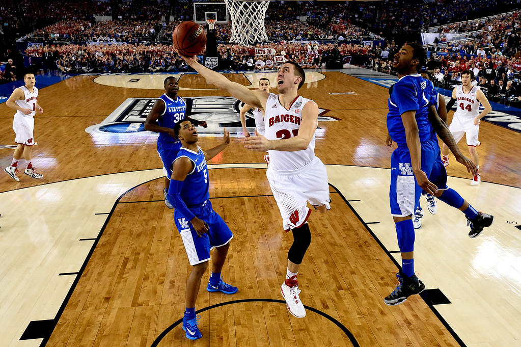. ARLINGTON, TX - APRIL 05: Josh Gasser #21 of the Wisconsin Badgers goes to the basket as James Young #1 of the Kentucky Wildcats defends during the NCAA Men\'s Final Four Semifinal at AT&T Stadium on April 5, 2014 in Arlington, Texas. (Photo by Chris Steppig-Pool/Getty Images)