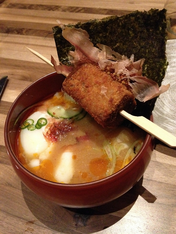 """. Logan \""""poser\"""" Ramen is a nontraditional take on the noodle bowl, with a crispy pork croquette suspended over the spicy broth. Kyle Wagner, The Denver Post"""