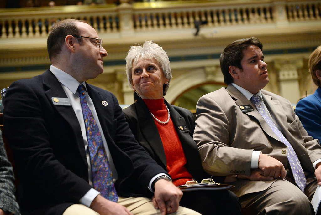 . (l-r) Representatives Paul Rosenthal, D-Denver, Joann Ginal, D-Fort Collins, and Dominick Moreno, D-Commerce City hold hands while listening to comments before a vote on civil union at the Colorado State Capitol in Denver, CO March 12, 2013. The three law makers are gay. Senate Bill 11 is sponsored by House Speaker Mark Ferrndino of Denver and Rep. Sue Schafer of Wheat Ridge, two gay Denver Democrats. The Bill passed and will allow gay couples to form civil unions in Colorado. (Photo By Craig F. Walker/The Denver Post)