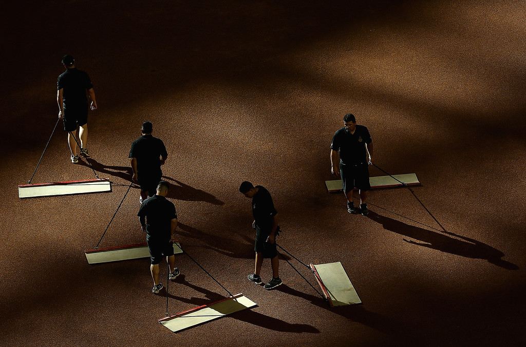 . The Arizona Diamondbacks grounds crew prepares the infield before the MLB game against the Colorado Rockies at Chase Field on April 30, 2014 in Phoenix, Arizona.  (Photo by Christian Petersen/Getty Images)