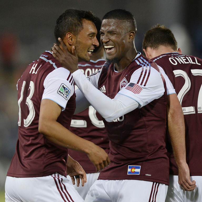 . Colorado forward Edson Buddle grabbed Kamani Hill by the neck after his goal in the second half. The Colorado Rapids defeated the Montreal Impact 4-1 Saturday night, May 24, 2014. (Photo by Karl Gehring/The Denver Post)