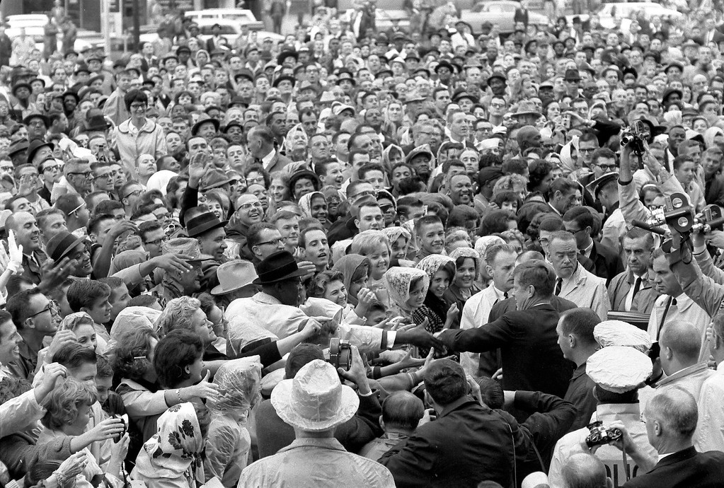 . Kennedy reaches out to the crowd at the Hotel Texas parking lot in Fort Worth on Nov. 22, 1963. Cecil Stoughton/John F. Kennedy Presidential Library and Museum