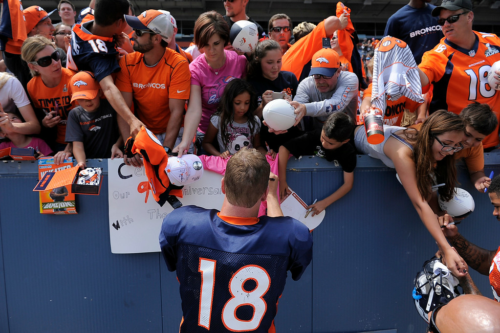 . Denver Broncos quarterback Peyton Manning (18) signs autographs after practice on day four of the Denver Broncos 2014 training camp July 27, 2014 at Sports Authority Field at Mile High. (Photo by John Leyba/The Denver Post)