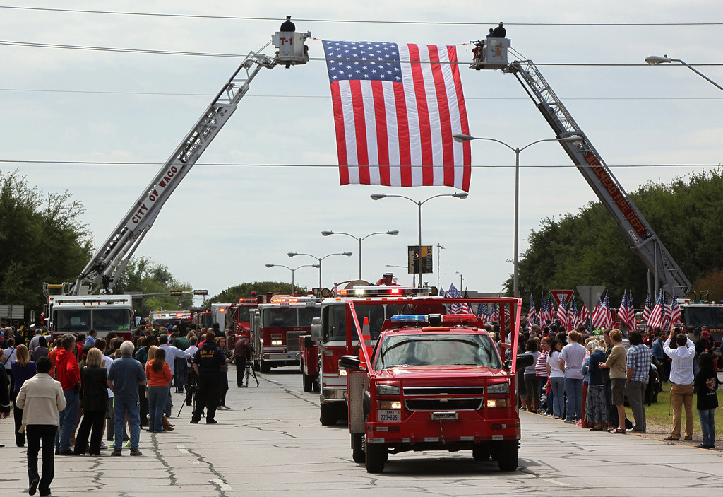 . Fire departments from around Texas pay their respects as they parade in to the West Memorial Service on April 25, 2013 in Waco, Texas. (Photo by Erich Schlegel/Getty Images)
