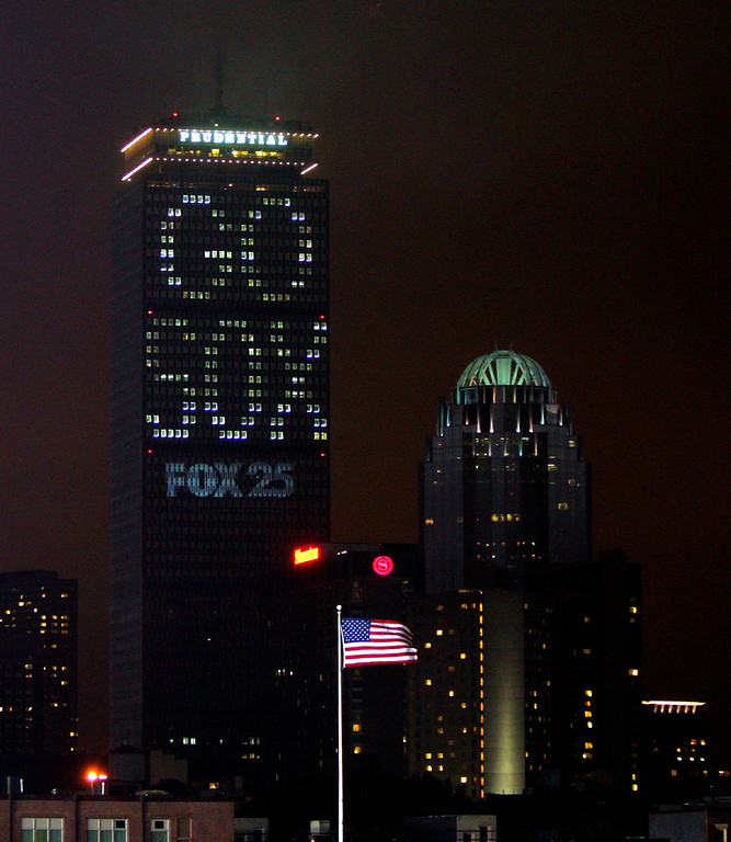 ". The Prudential Building in downtown Boston is lit up with ""Go Sox\"" on Sunday, Oct. 24, 2004, before the start of Game 2 of the World Series against the Boston Red Sox and the St. Louis Cardinals.  (AP Photo/Chitose Suzuki)"