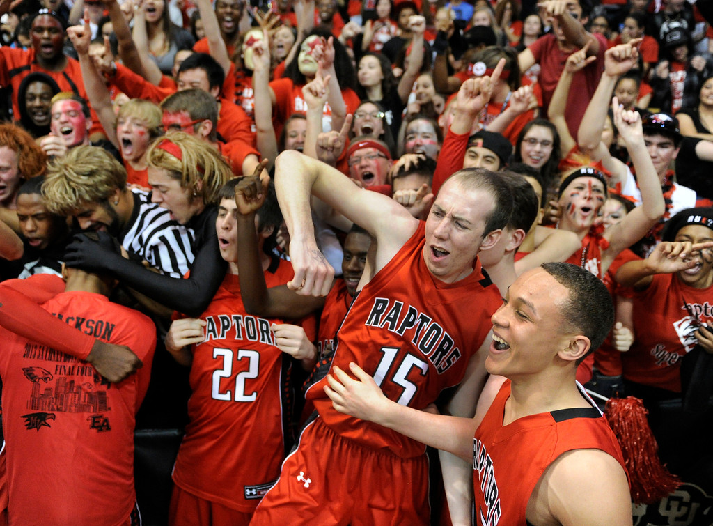 . BOULDER, CO. - MARCH 16: The Raptors celebrated with fans after beat East Saturday night. The Eaglecrest High School boy\'s basketball beat Denver East 63-44 in the 5A championship game Saturday, March 16, 2013 at the Coors Events Center in Boulder.  (Photo By Karl Gehring/The Denver Post)