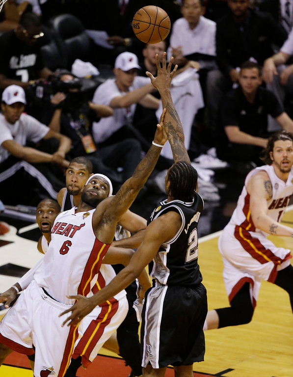. The Miami Heat\'s LeBron James (6) touches the arm of San Antonio Spurs\' Kawhi Leonard (2) during the second half in Game 7 of the NBA basketball championships, Thursday, June 20, 2013, in Miami. (AP Photo/Wilfredo Lee)