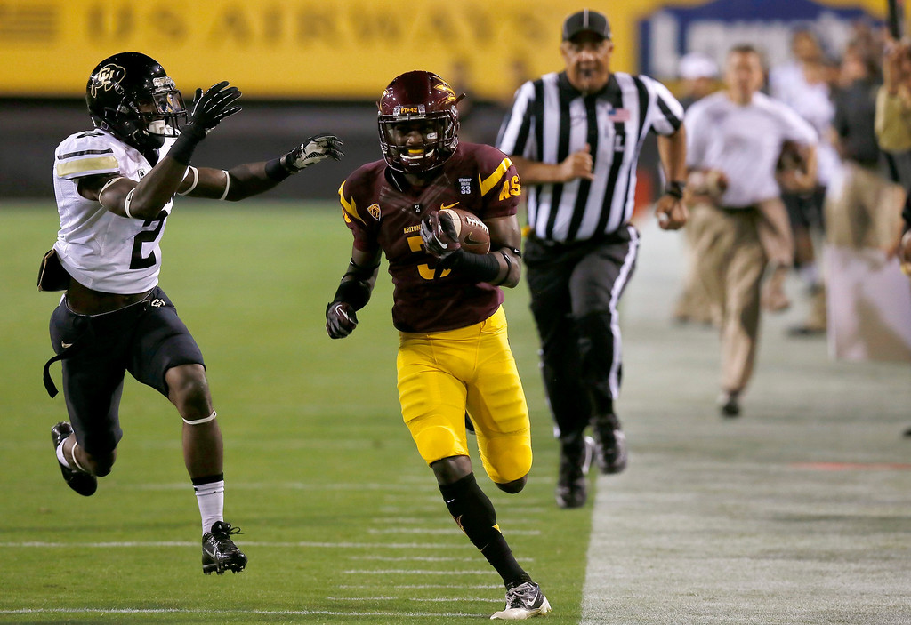. Arizona State\'s Richard Smith, front right, runs with the ball as Colorado\'s Kenneth Crawley (2) tries to chase him down during the first half of an NCAA college football game on Saturday Oct. 12, 2013, in Tempe, Ariz. (AP Photo/Ross D. Franklin)
