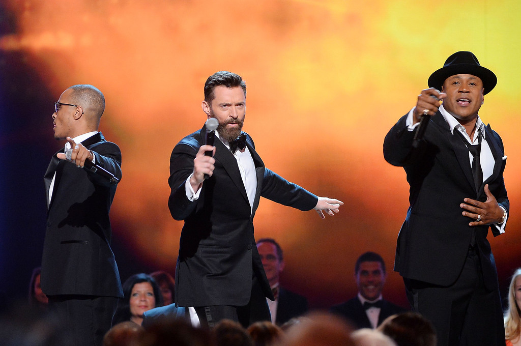 . T.I., Hugh Jackman and LL Cool J perform onstage during the 68th Annual Tony Awards at Radio City Music Hall on June 8, 2014 in New York City.  (Photo by Theo Wargo/Getty Images for Tony Awards Productions)