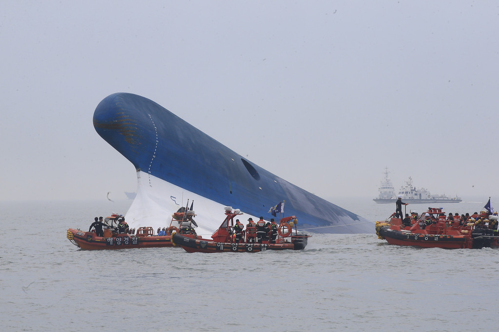 . In this handout provided by Donga Daily, The Republic of Korea Coast Guard work at the site of ferry sinking accident off the coast of Jindo Island  on April 16, 2014 in Jindo-gun, South Korea.  (Photo by Park Young-Chul-Donga Daily via Getty Images)