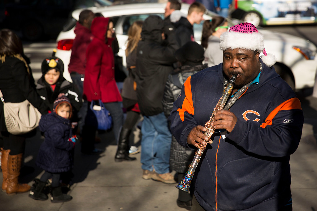 . Kaliq Woods plays clarinet for passing shoppers on Michigan Ave. during Black Friday shopping on Friday, Nov. 29, 2013, in Chicago. Black Friday, the day after Thanksgiving, is typically the nation\'s biggest shopping day of the year. (AP Photo/Andrew A. Nelles)