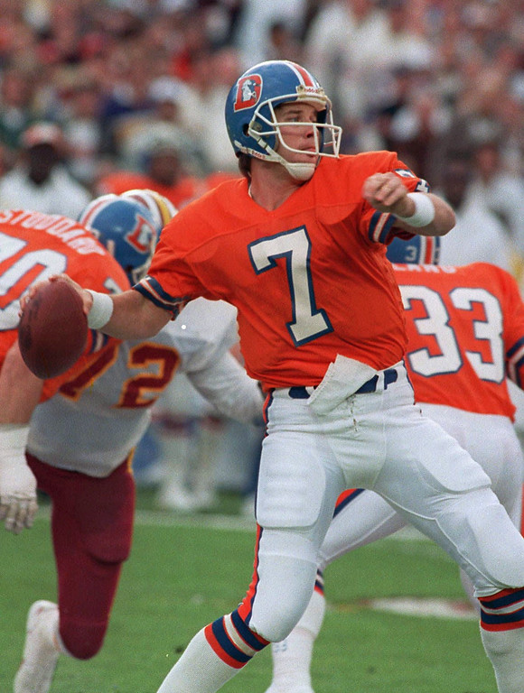 . Denver Broncos quarterback John Elway winds up to let go of a 56-yard touchdown pass to wide receiver Ricky Nattiel in the first quarter of Super Bowl XXII against the Washington Redskins in San Diego, Calif., Jan. 31, 1988.  (AP Photo/Amy Sancetta)