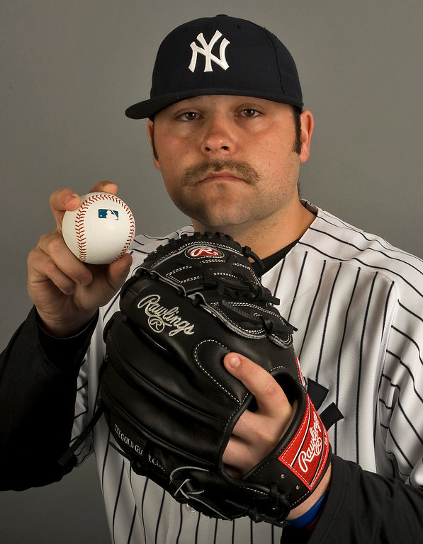 . New York Yankees pitcher Joba Chamberlain poses for a photograph during media photo day at the team\'s MLB spring training complex at George M. Steinbrenner Field in Tampa, Florida, February 20, 2013. REUTERS/Steve Nesius