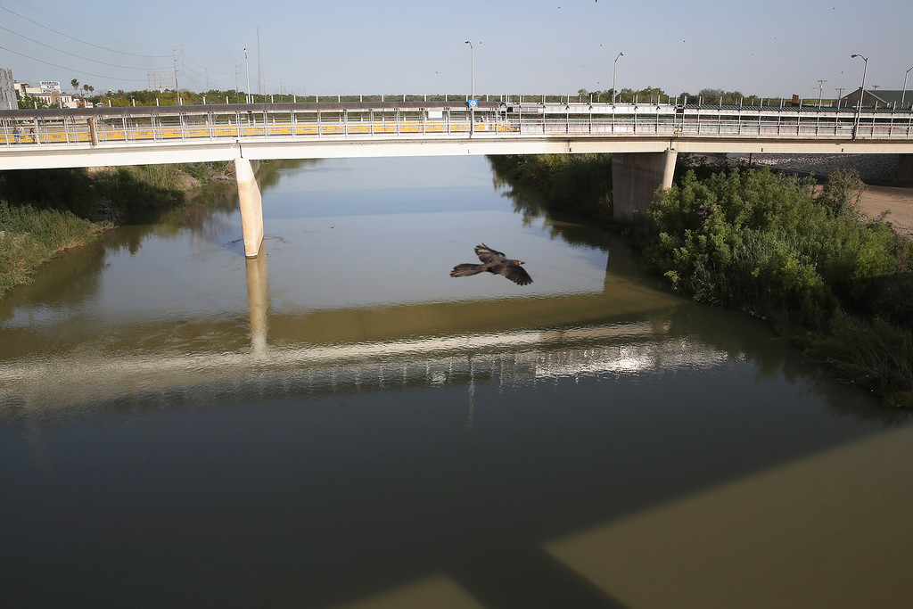 . HIDALGO, TX - APRIL 11:  An international bridge spans the Rio Grande River at the U.S.-Mexico border on April 11, 2013 in Hidalgo, Texas. According to the U.S. Border Patrol, undocumented immigrant crossings have increased more than 50 percent in Texas\' Rio Grande Valley sector in the last year. Border Patrol agents say they have also seen an additional surge in immigrant traffic since immigration reform negotiations began this year in Washington D.C. Proposed refoms could provide a path to citizenship for many of the estimated 11 million undocumented workers living in the United States.  (Photo by John Moore/Getty Images)