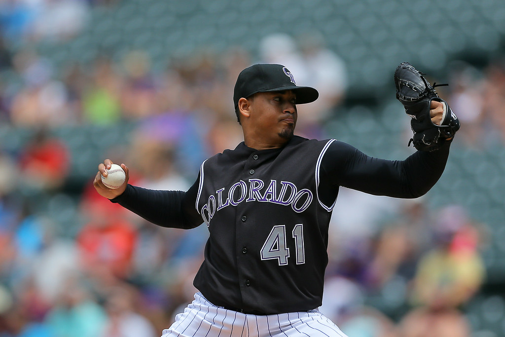 . DENVER, CO - JULY 9:  Jair Jurrjens #41 of the Colorado Rockies delivers to home plate during the third inning against the San Diego Padres at Coors Field on July 9, 2014 in Denver, Colorado. (Photo by Justin Edmonds/Getty Images)