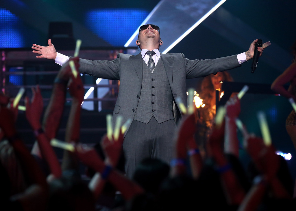 """. LOS ANGELES, CA - DECEMBER 16:  Recording artist Pitbull performs onstage during \""""VH1 Divas\"""" 2012 at The Shrine Auditorium on December 16, 2012 in Los Angeles, California.  (Photo by Christopher Polk/Getty Images)"""