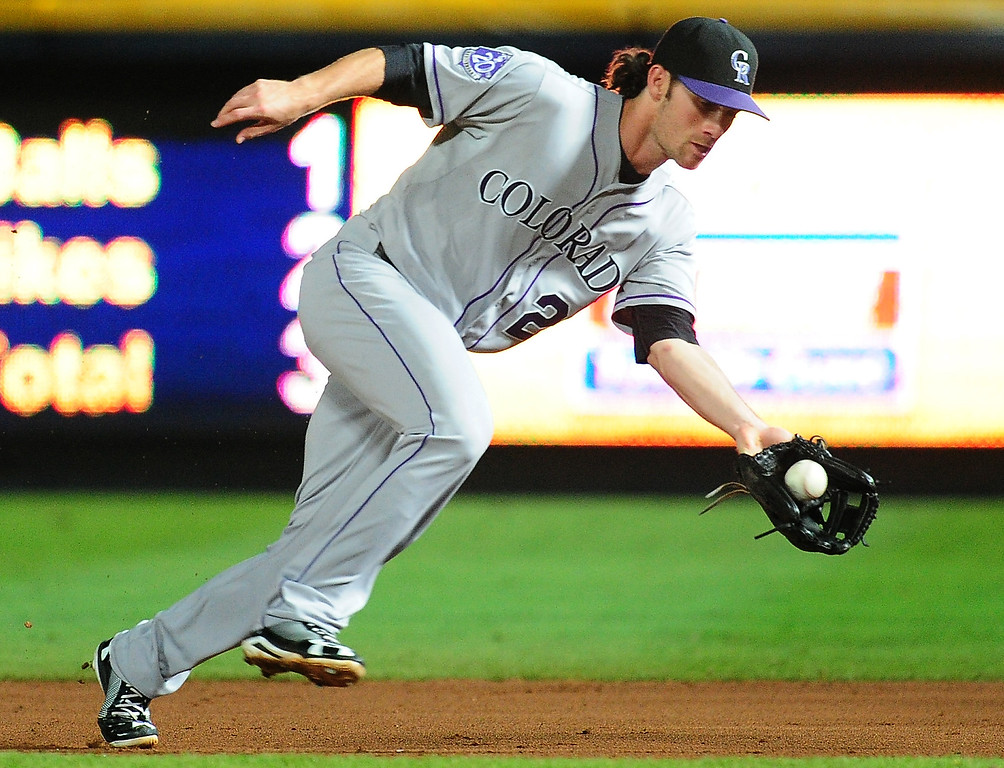 . Charlie Culberson #23 of the Colorado Rockies fields a ground ball against the Atlanta Braves at Turner Field on August 1, 2013 in Atlanta, Georgia. (Photo by Scott Cunningham/Getty Images)