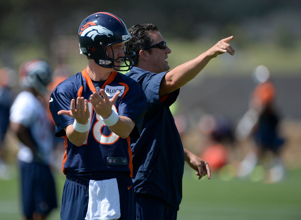 . Denver Broncos Peyton Manning (18) and quarterbacks coach Greg Knapp give out directions in drills during OTAs June 10, 2014 at Dove Valley. (Photo by John Leyba/The Denver Post)