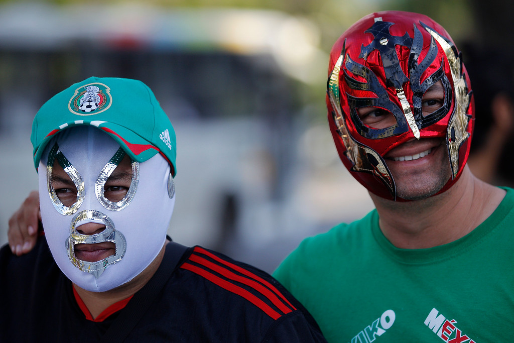 . Mexican soccer fans pose for the photo wearing wrestling masks in front of Maracana stadium, in Rio de Janeiro, Brazil, Wednesday, June 11, 2014. The World Cup soccer tournament starts Thursday. (AP Photo/Leo Correa)