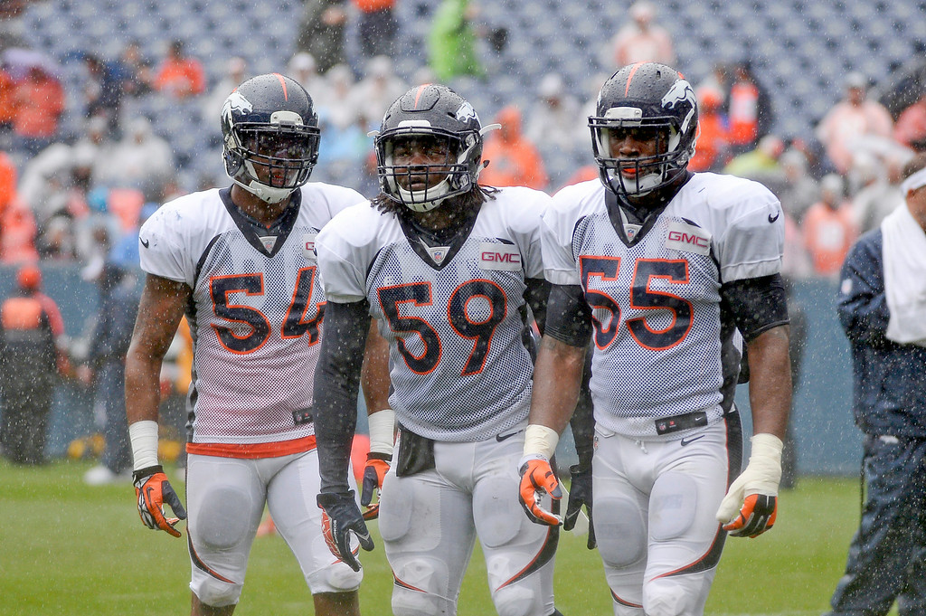 . Denver Broncos linebacker Brandon Marshall (54) Denver Broncos outside linebacker Danny Trevathan (59) Denver Broncos outside linebacker Lerentee McCray (55) line up in drills during a rain day on day six of the Denver Broncos 2014 training camp July 30, 2014 at Sports Authority Field at Mile High Stadium.  (Photo by John Leyba/The Denver Post)