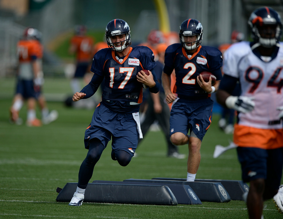 . Denver Broncos quarterback Brock Osweiler (17) runs through drills during practice August 26, 2014 at Dove Valley.(Photo by John Leyba/The Denver Post)