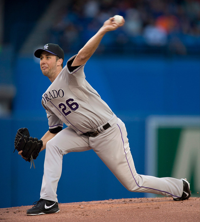 . Colorado Rockies pitcher Jeff Francis throws against the Toronto Blue Jays during first inning of a baseball game in Toronto on Tuesday June 18, 2013. (AP Photo/The Canadian Press, Frank Gunn)
